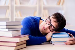 The male student preparing for exams in college library. Male student preparing for exams in college library Royalty Free Stock Images