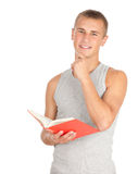 Male student reading book. Standing male student in casual shirt reading book, white background Royalty Free Stock Photo