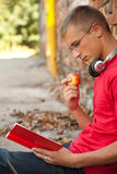 Male student reading book Royalty Free Stock Images