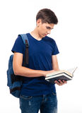 Male student reading book. Isolated on a white background Royalty Free Stock Photography