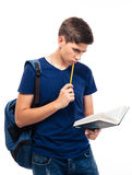 Male student reading book. Isolated on a white background Royalty Free Stock Images