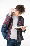 Male student reading book. Over gray background Stock Images