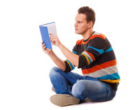 Male student reading a book preparing for exam isolated. Full length male student sitting on floor reading a book preparing for exam isolated on white background Stock Photography