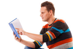 Male student reading a book preparing for exam isolated. Portrait of a male student sitting reading a book preparing for exam isolated on white Royalty Free Stock Image
