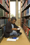 Male student reading in the library Stock Photos