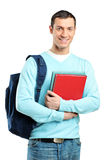 A male student with a school bag holding books. Isolated on white background Stock Images