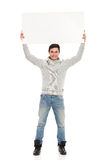 Male student showing banner. Stock Photo