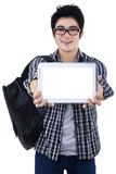 Male student showing copyspace on digital tablet Royalty Free Stock Photos