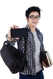 Male student showing mobilephone Royalty Free Stock Photography