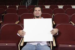 Male Student With Sign Board In Classroom Royalty Free Stock Photo