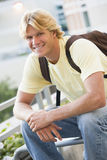 Male student sitting outside stock images