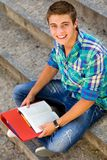 Male student sitting on stairs Royalty Free Stock Image