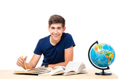 Male student sitting at the table with books Stock Photos