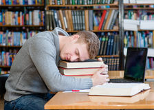 Male student sleep in library.  Royalty Free Stock Images