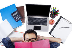 Male student sleeping on the floor after studying Stock Photos