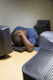 Male student sleeping at his computer Royalty Free Stock Photos