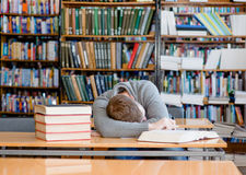 Male student sleeping in library.  Stock Image