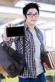 Male student with a smartphone in classroom Royalty Free Stock Photos