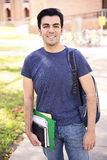 Male student smiling. Male student with a notebook at the university and smiling Stock Image