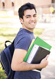 Male student smiling. Male student with a notebook at the university and smiling Royalty Free Stock Photos