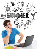 Male student smiling thinking of summer holiday Stock Photo