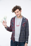 Male student standing with bills of dollars Stock Photo