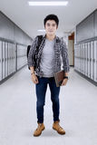 Male student standing in the corridor campus Stock Photography