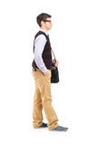 Male student standing in line. Full length portrait of a male student standing in line  against white background Royalty Free Stock Photography