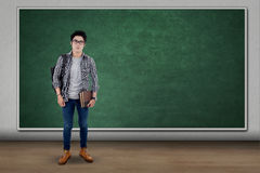 Male student standing near the chalkboard Stock Image
