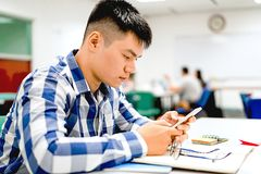 Male student study in the campus | Using smartphone. For more information Stock Photo