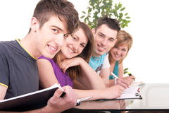 Male student studying with his classmates Stock Photos