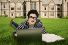 Male student studying outdoors 1. Portrait of male high school student studying on the park Stock Photography