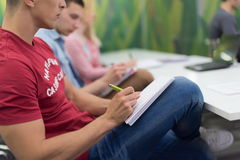 Male student taking notes in classroom. Business education concept, casual young businessman on seminar training Royalty Free Stock Photography