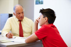 Male Student Talking To High School Councillor Stock Photo