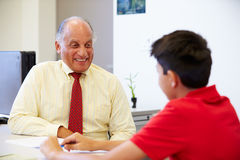 Male Student Talking To High School Councillor stock photography