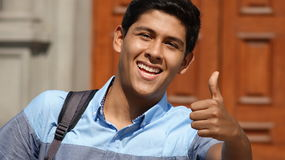 Male Student Thumbs Up. Stock photo of a teen Royalty Free Stock Photo