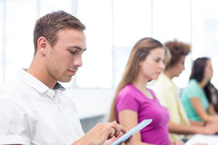 Male student using digital tablet in computer class Stock Photos