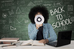 Male student using megaphone in the classroom Stock Photos