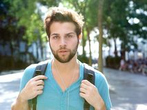 Male student walking outdoors with bag Stock Photography