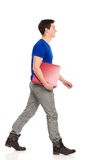 Male student walking. Smiling young man walking with red ring binder. Full length studio shot isolated on white Stock Image