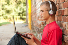 Male student working on laptop Royalty Free Stock Photos