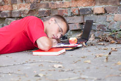 Male student working on laptop. Working on laptop male student sleeping outdoors Royalty Free Stock Photos