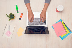 Male student working with laptop on desk. Top view.  Royalty Free Stock Image
