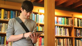 Male student working with a tablet Royalty Free Stock Photos