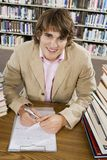 Male Student Writing Notes Stock Images
