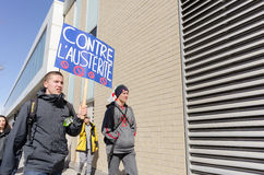Male students holding pancard against gouvernement austerity. 2015,AVRIL 02-MONTREAL,CANADA Male students protesting against government austerity plans to cut Royalty Free Stock Images