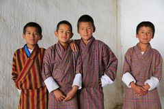 Male Students at Local Festival, Bhutan. Colorfully-dressed, young male students pose  for a portrait while attending a Buddhist festival in Bhutan Royalty Free Stock Images