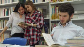 Male students reads the book at the library stock images