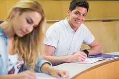 Male students smiling at camera. At the lecture hall Royalty Free Stock Images