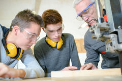 Male students in woodwork class. Male students in a woodwork class Royalty Free Stock Photos